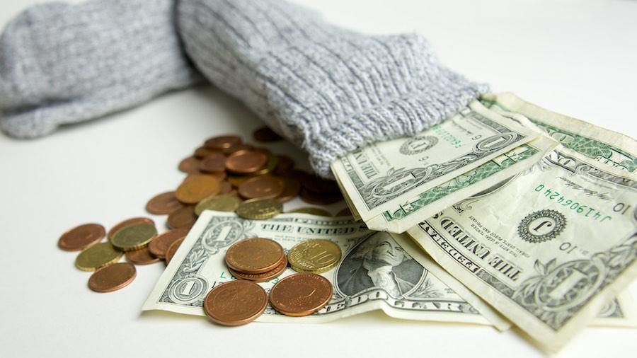 Kosten websitebouw door Textmaker. Sok met geld.
